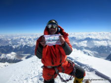 Alan with sponsor flag on K2 summit